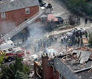 In this Sept. 27, 2016 file photo, emergency service personnel work at the scene of a house explosion in the Bronx borough of New York where firefighter Michael Fahy, a 17-year fire department veteran was killed after responding to a report of a gas leak at the home. (AP Photo/Mary Altaffer, File)