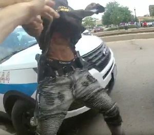 This frame grab from police body cam video provided by the Chicago Police Department shows authorities trying to apprehend a suspect who appeared to be armed, Saturday, July 14, 2018, in Chicago. The suspect was fatally shot by police during the confrontation. (Chicago Police Department via AP)