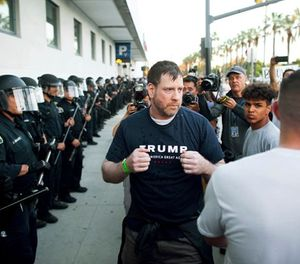 In this June 2, 2016 file photo, a man leaving a campaign rally for Republican presidential candidate Donald Trump squares off against protesters following him in San Jose, Calif. A federal appeals court is allowing supporters of then-presidential candidate Donald Trump to sue, alleging they were beaten after San Jose police steered them into a crowd of anti-Trump protesters. (AP Photo/Noah Berger, File)