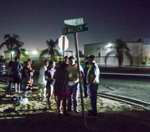 A crowd gathers near a location where a gunman opened fire, killing several people, Wednesday, Sept. 12, 2018, in Bakersfield, Calif. A gunman killed five people, including his wife, before turning the gun on himself, authorities said. (Felix Adamo/The Bakersfield Californian via AP)