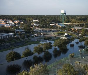 Floodwaters surround tennis courts after Hurricane Florence struck the Carolinas. (Photo/AP)