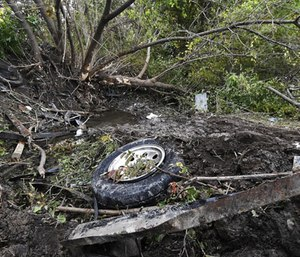 Debris scatters an area Sunday, Oct. 7, 2018, at the site of a fatal crash in Schoharie, N.Y. (Photo/AP)