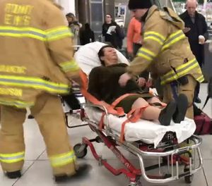 In this still image taken from video provided by WNBC-TV News 4 New York, emergency medical personnel tend to an injured passenger from a Turkish Airlines flight at New York's John F. Kennedy International Airport.