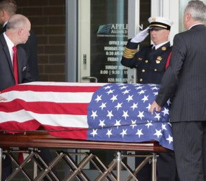 The casket of Appleton firefighter Mitchell F. Lundgaard appears at the Appleton Alliance Church on Monday, May 20, 2019, in Grand Chute, Wis. The 14-year veteran of the Appleton Fire Department was fatally shot while responding to a medical emergency at the downtown Valley Transit Center on May 15, in Appleton, Wis. (William Glasheen/The Post-Crescent via AP)