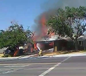 In this image taken from video provided by Ben Hood, a firefighter works to extinguish a fire following an earthquake in Ridgecrest, Calif. (Ben Hood via AP)