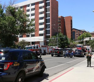 Rescue personnel respond to an explosion that damaged Argenta and Nye Halls on the University of Nevada, Reno. (Photo/Jason Bean/The Reno Gazette-Journal via AP)