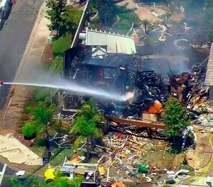 This image from video provided by CBS-LA shows the aftermath of an explosion that destroyed a house in Murrieta, Calif., sending up thick flames and closing several streets. (CBS-LA via AP)