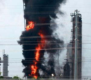 Flames and smoke emanate from an Exxon Mobil facility in Baytown, Texas. (Photo/Yi-Chin Lee/Houston Chronicle via AP)