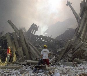 Destroyed mullions, the vertical struts which once faced the soaring outer walls of the World Trade Center towers, are examined by emergency workers, after a terrorist attack on the twin towers of lower Manhattan Tuesday, Sept. 11, 2001. (AP Photo/Mark Lennihan)