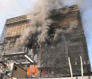 A fire that claimed the lives of two firefighters burns in the former Deutsche Bank office building in New York. (Photo/AP)