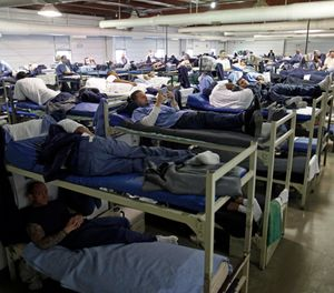 A room full of inmates are seen in their bunk beds at Southeastern Correctional Institution Wednesday, April 22, 2009 in Lancaster, Ohio. (AP Photo/Kiichiro Sato)