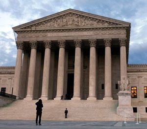 In this March 25, 2012, file photo, people visit the Supreme Court in Washington. (AP Photo/Jacquelyn Martin, File)