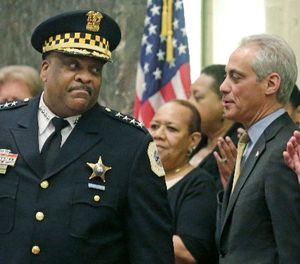 In this April 13, 2016 photo, Chicago Police Superintendent Eddie Johnson speaks with Mayor Rahm Emanuel at Johnson's swearing-in ceremony in Chicago. (AP Photo/M. Spencer Green)
