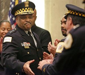 In this April 13, 2016 file photo, Chicago's police superintendent Eddie Johnson, left, shakes hands with other officers at a city council meeting in Chicago. (AP Photo/M. Spencer Green File)