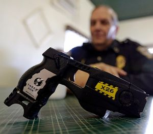 This Nov. 14, 2013, file photo, shows a Taser X26 on display. (AP Photo/Michael Conroy, File)