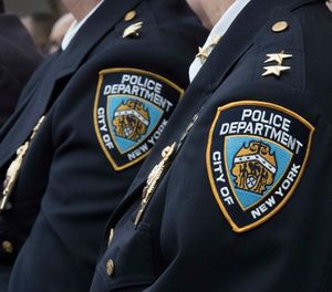 Police brass listens as New York City Mayor Bill de Blasio, and NYPD Commissioner Jim O'Neil conduct a news conference, Wednesday, Jan. 4, 2017, in New York. (AP Photo/Mary Altaffer)