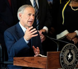 In this Friday, July 8, 2016 file photo, Texas Gov. Greg Abbott, right, responds to questions during a news conference at City Hall in Dallas. (AP Photo/Tony Gutierrez, File)