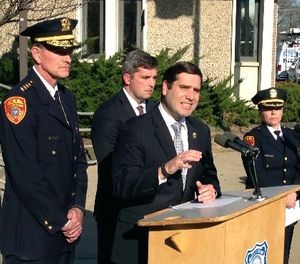 Suffolk County Police Commissioner Timothy Sini, center, addresses the media outside Police Headquarters in Bay Shore, N.Y., Friday, April 14, 2017. (AP Photo/Frank Eltman)