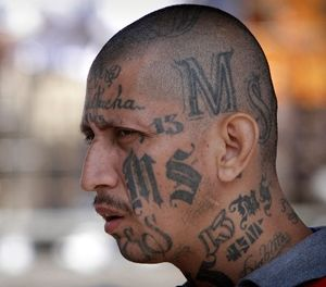 In this March 26, 2012 file photo a gang member of MS-13 attends mass at a prison in Ciudad Barrios, El Salvador. (AP Photo/Luis Romero, File)