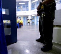 Former NM CO accused of abetting inmate sues state