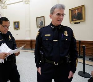 Houston Police Chief Art Acevedo, left, and San Antonio Police Chief William McManus, right, stand in the rotunda at the Texas CapitolTuesday, July 25, 2017, in Austin, Texas. (AP Photo/Eric Gay)