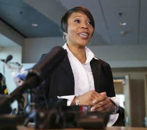 Dallas Police Chief Reneé Hall talks to reporters during an applicant processing event at police headquarters in Dallas, Thursday, Sept. 7, 2017. (AP Photo/LM Otero)