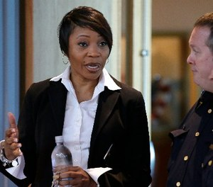 New Dallas Police Chief Reneé Hall talks during an applicant processing event at police headquarters in Dallas, Thursday, Sept. 7, 2017. (AP Photo/LM Otero)