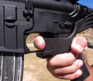 """Shooting instructor Frankie McRae illustrates the grip on an AR-15 rifle fitted with a """"bump stock"""" at his 37 PSR Gun Club in Bunnlevel, N.C., on Wednesday, Oct. 4, 2017. (AP Photo/Allen G. Breed)"""