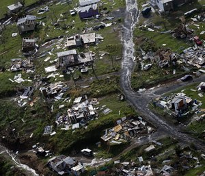 Debris scatters a destroyed community in the aftermath of Hurricane Maria in Toa Alta, Puerto Rico. (Photo/Gerald Herbert, AP)
