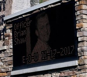 The electronic sign for Mount Saint Peter Church displays an image of New Kensington Police Officer Brian Shaw on Monday, Nov. 20, 2017, in New Kensington, Pa. (AP Photo/Keith Srakocic)
