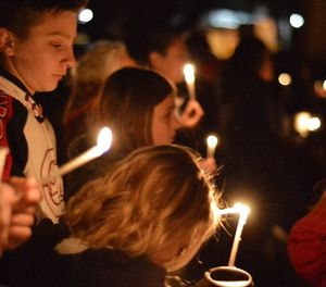 Aztec High School students and area residents gather for a candlelight vigil in Aztec, N.M., Thursday, Dec. 7, 2017, after a shooting at the high school. (AP Photo/Russell Contreras)
