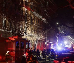 Firefighters respond to a deadly building fire in the Bronx borough of New York. (Photo/AP)