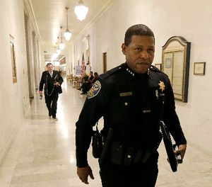 This Tuesday, Dec. 12, 2017 file photo San Francisco Police Chief William Scott walks to a meeting at City Hall in San Francisco. (AP Photo/Jeff Chiu,File)