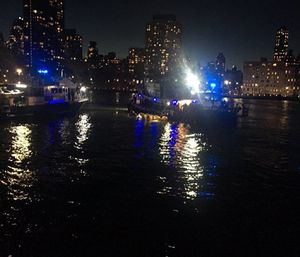 A pilot who survived when his helicopter went down in New York City's East River, killing five passengers, said in an emergency radio transmission that the aircraft's engine had failed. (Photo/AP)