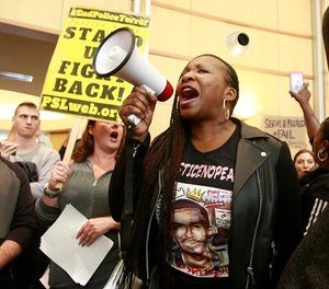 Veronica Curry and other protestors crowd the entrance to the Sacramento City Hall to protest the shooting of Stephon Alonzo Clark, by a pair of Sacramento Police officers, during a demonstration, Thursday, March 22, 2018, in Sacramento, Calif. (AP Photo/Rich Pedroncelli)