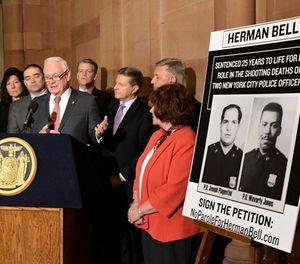 New York Sen. Martin Golden, R-Brooklyn, stands with legislators urging the parole board to reverse its decision to release inmate Herman Bell who was convicted in the 1971 murder of two New York City police officers during a news conference at the state Capitol Thursday, March 29, 2018, in Albany, N.Y. (AP Photo/Hans Pennink)