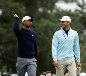 Tiger Woods, Matt Parziale and Fred Couples walk up the first fairway during a practice round for the Masters golf tournament Wednesday, April 4, 2018, in Augusta, Ga. (AP Photo/Chris Carlson)