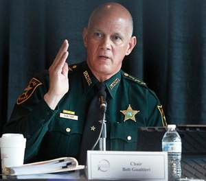 Sheriff and chairperson, Bob Gualtieri, of Pinellas county, Fla., speaks during a state commission meeting as they investigate the Marjory Stoneman Douglas High School massacre and how Broward school district and others access threats, on Tuesday, July 10, 2018, in Sunrise, Fla. (AP Photo/Brynn Anderson)
