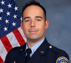 Authorities say Flynn, a 13-year veteran of the department, died after he fell through the floor at a burning Clarksville, Maryland home and was trapped for 22 minutes. (Howard County, Md., Fire and Rescue Department via AP)