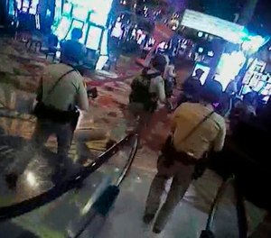 In this Oct. 1, 2017, image taken from body-camera video provided by the Las Vegas Metropolitan Police Department, officers search Las Vegas Strip casinos following a shooting that killed 58 people and injured more than 800 in Las Vegas. (Las Vegas Metropolitan Police Department via AP)