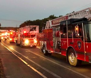 Multiple fire trucks from surrounding communities arrive Thursday, Sept. 13, 2018, in Lawrence, Mass., responding to a series of gas explosions and fires triggered by a problem with a gas line that feeds homes in several communities north of Boston. (AP Photo/Phil Marcelo)