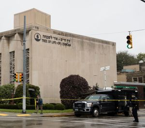 Police stand guard outside the Tree of Life Synagogue in Pittsburgh where a shooter opened fire Saturday, Oct. 27, 2018. (AP Photo/Matt Rourke)