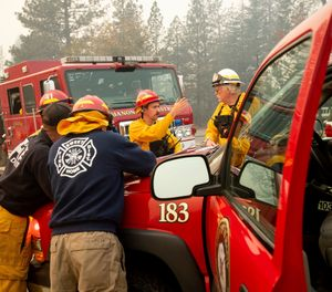 As first responders brave the worst nature has to offer to save neighbors' lives and property, many have had to leave their own families to fend for themselves or watch as their own homes go up in flames. (Photo/AP)