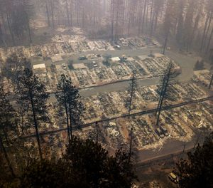 In this Thursday, Nov. 15, 2018, file photo, residences leveled by the wildfire line a neighborhood in Paradise, Calif. Northern California crews battling the country's deadliest wildfire in a century were bracing for strong winds Sunday, Nov. 18, that could erode gains they have made in containing the fearsome blaze, which has killed dozens and leveled a town. (AP Photo/Noah Berger, File)