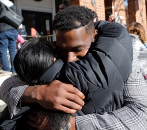 Marcus Martin, who was injured during the 2017 car attack, hugs a supporter after a jury recommended life plus 419 years for James Alex Fields Jr. (AP Photo/Steve Helber)