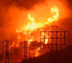 During a government shutdown, many federal firefighters are unable to perform vital steps to minimize the loss of life and property during what has become, in many areas, a year-long season of wildfires. (Photo/AP)