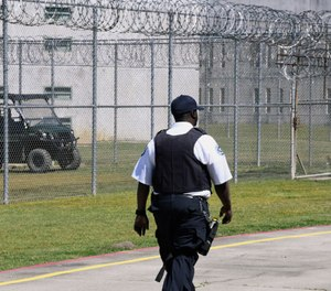 Prison staff work at Lee Correctional Institution on Wednesday, April 10, 2019, in Bishopville, S.C. (AP Photo/Meg Kinnard)