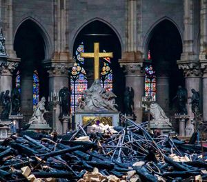 Debris are seen inside Notre Dame cathedral in Paris, Tuesday, April 16, 2019. Firefighters declared success Tuesday in a more than 12-hour battle to extinguish an inferno engulfing Paris' iconic Notre Dame cathedral that claimed its spire and roof, but spared its bell towers and the purported Crown of Christ. (Christophe Petit Tesson, Pool via AP)