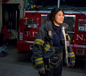 New York City firefighter Sarinya Srisakul speaks about her work in the FDNY Tuesday, Jan. 28, 2014, at a Manhattan fire house. Srisakul, who didn't work with another woman for five years. (AP Photo/Craig Ruttle)