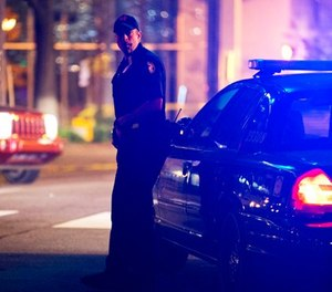 A police officer stands near the scene of an officer-involved shooting, Tuesday, Dec. 1, 2015, in downtown Atlanta. (AP Photo/David Goldman)